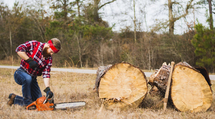 Lumberjack with an 18 inch chainsaw